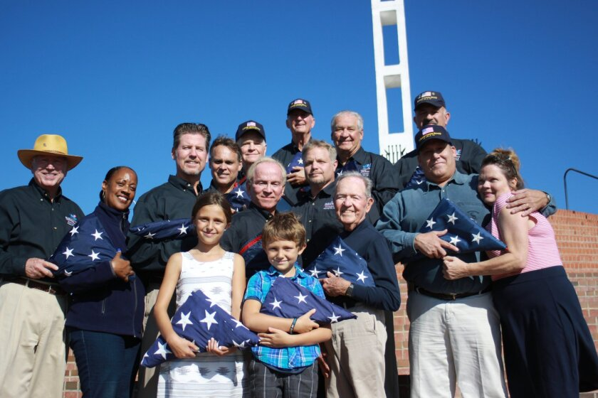 Mount Soledad's retiring flag team gathers with family and friends (from front left): Jim Kitchel, Denise Larkins, Chris Townson, Cameron and Jeremy Cromwell, Michael Gerber, Bert Mawhinney, Rick and Cindy Preskitt, Jaime Tollefson, Shawn Cromwell, Warren Morgans, Allen McAnally, Jim Kyers and Bruce Bailey.