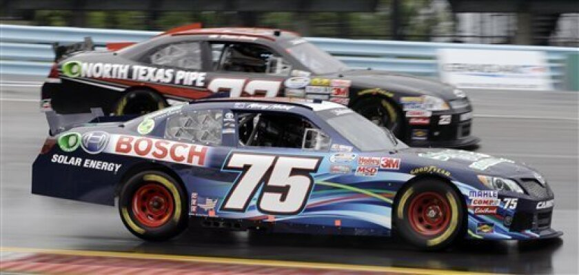 Kenny Habul (75) drives through Turn 1 with Dexter Stacey (23) during practice for the NASCAR Nationwide Series auto race at Watkins Glen International in Watkins Glen, N.Y., Friday, Aug. 10, 2012. (AP Photo/David Duprey)