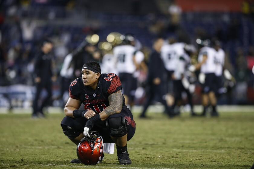 Junior center Keith Ismael, shown after a 31-30, overtime loss to Hawaii last season, is an all-Mountain West conference pick.a