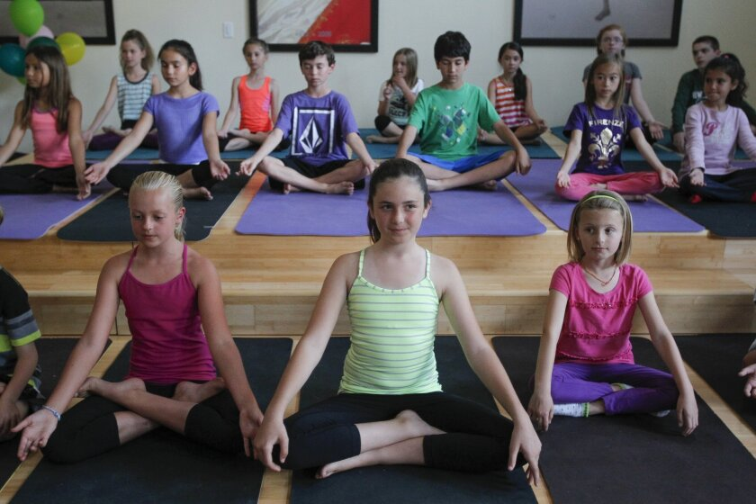 La Costa Heights Elementary School students demonstrate yoga for parents and other adults.