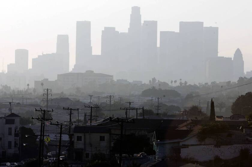 A hazy day in Los Angeles. A new report says California will fall short of its goal to slash greenhouse gas emissions by midcentury unless it adopts aggressive policies to fight climate change.
