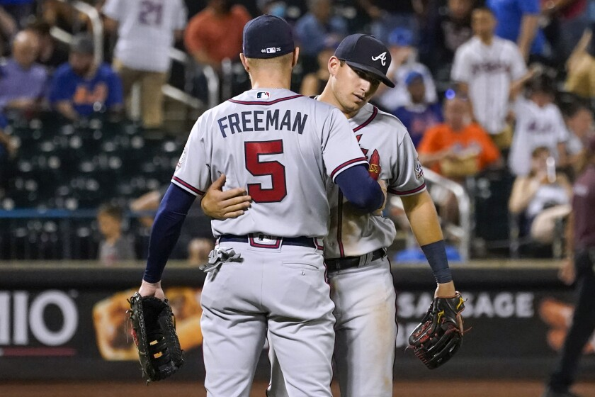 Atlanta Braves' Austin Riley and Freddie Freeman (5) celebrate at the end of the team's baseball game against the New York Mets, Tuesday, July 27, 2021, in New York. The Braves won 12-5. (AP Photo/Mary Altaffer)
