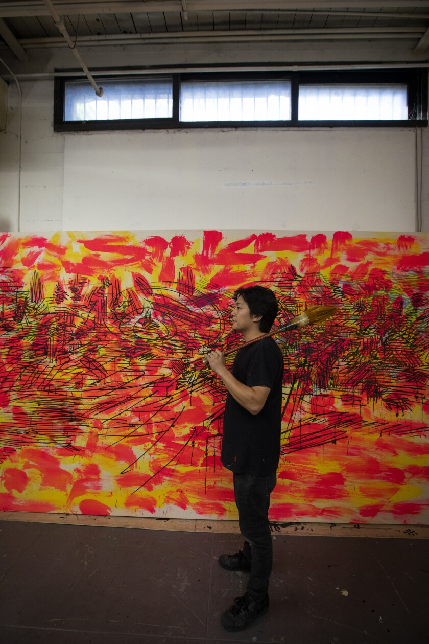Artist Duke Choi, 30, in his space at Santa Fe Art Colony in Los Angeles.
