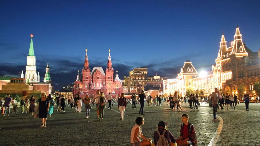 Like much of Moscow, Red Square is lit up at night. In this view, the State History Museum is straig