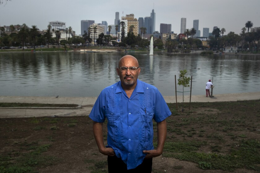 "Roberto Lovato, author of ""Unforgetting,"" at MacArthur Park Lake."