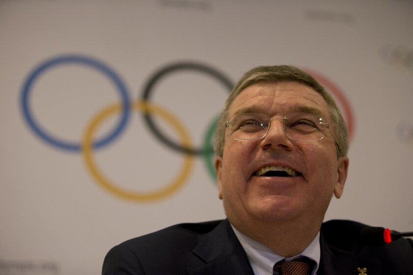 International Olympic Committee President Thomas Bach smiles during a press conference in Rio de Janeiro, Brazil, Saturday, Feb. 28, 2015. IOC officials have been in Rio this week monitoring progress on the games. South America's first Olympics open Aug. 5. 2016. (AP Photo/Silvia Izquierdo)