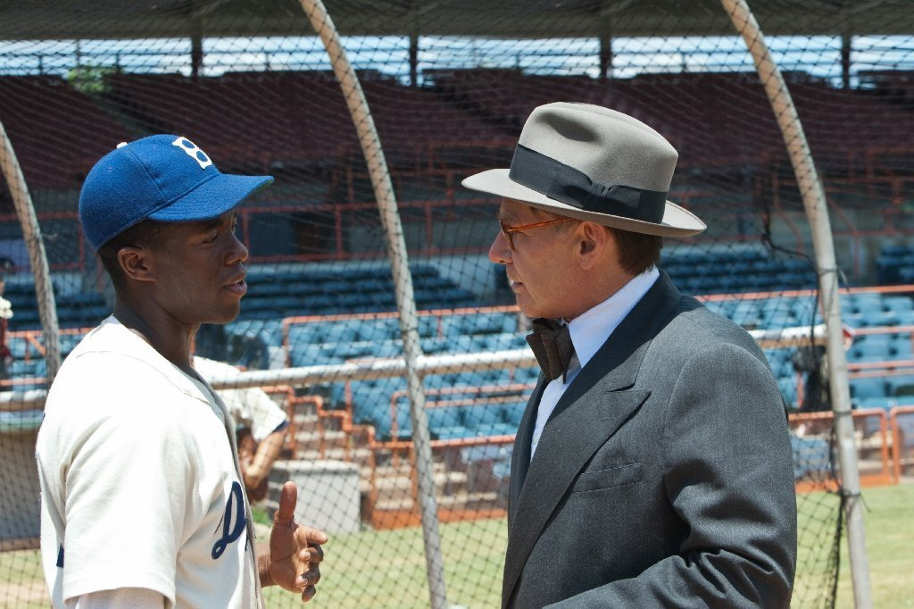 The players: Chadwick Boseman stars as Jackie Robinson and Harrison Ford plays Branch Rickey, the Dodgers general manager who signed the baseball player to the team. Rickey's great-granddaughter, Kelley Jakle, also has a small role in the film. | How it changed the game: Robinson, who wore number 42, is universally revered for breaking the color barrier in Major League Baseball in 1947.