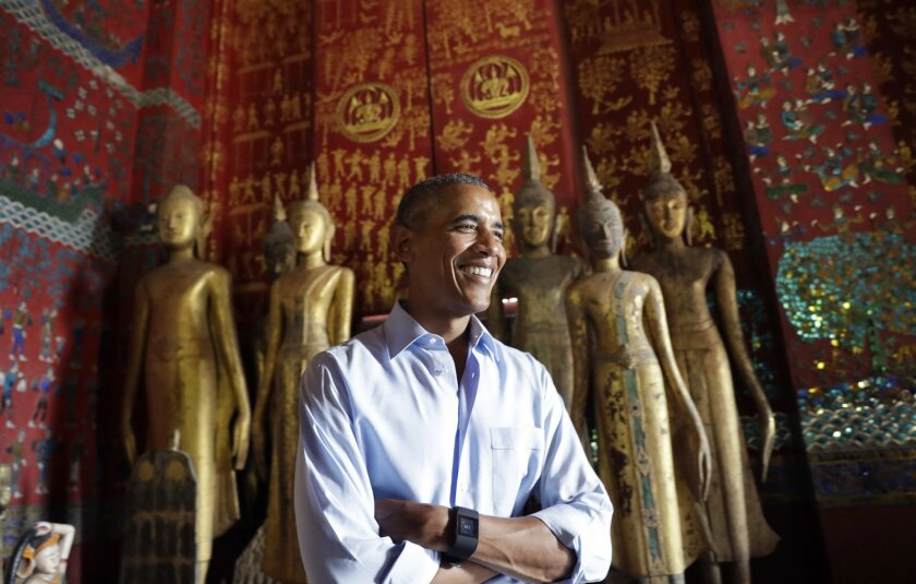 U.S. President Barack Obama pauses in the Ho Raj Rod, or Carriage House, as he tours the Wat Xieng Thong Buddhist Temple in Luang Prabang, Laos, Wednesday, Sept. 7, 2016. (AP Photo/Carolyn Kaster)