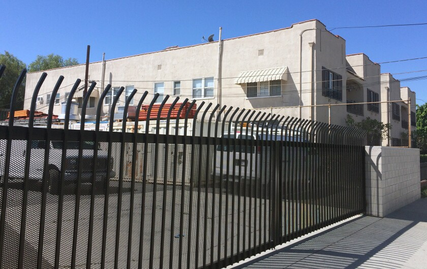 Trustees of this residential property located on Palmer Avenue have sued Glendale Unified, whose facilities operations site is located next door, for diminishing the quality of life and property values nearby.