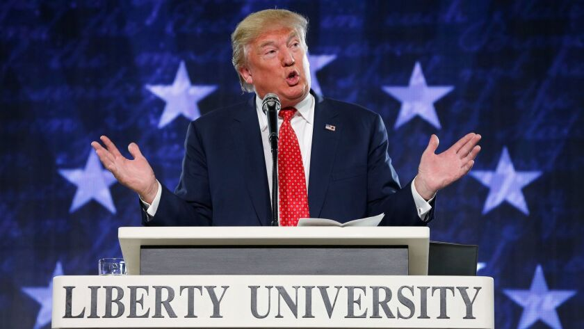FILE - In this Jan. 18, 2016 file photo, Donald Trump gestures during a speech at Liberty University