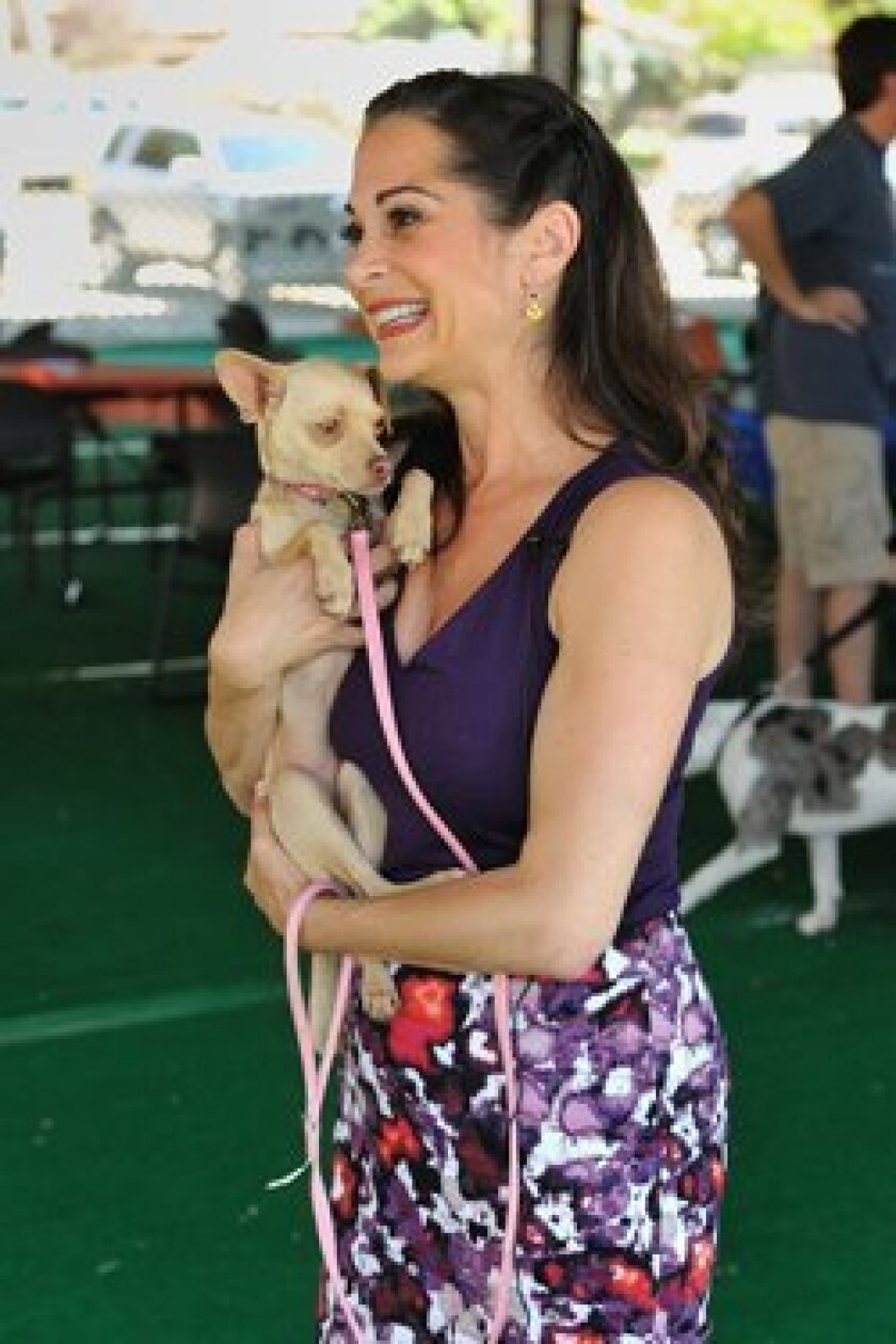 Woodward Center PR Manager Jessica Gercke holds CindyLou at the Center's 40th anniversary party. Photo/Jon Clark