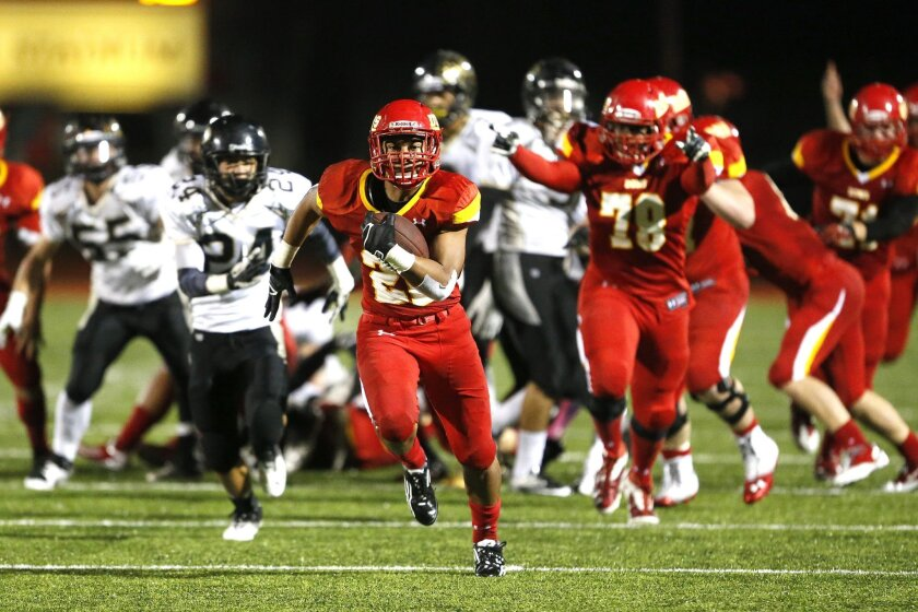 Cathedral Catholic fullback Chris Moliga rumbles toward the end zone in the second quarter for a 45-yard touchdown scamper on a fourth-and-2 play.