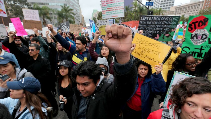 Protesters in downtown Los Angeles march against President Trump's immigration policies, including the border wall and the Musilm ban, on Feb. 18.