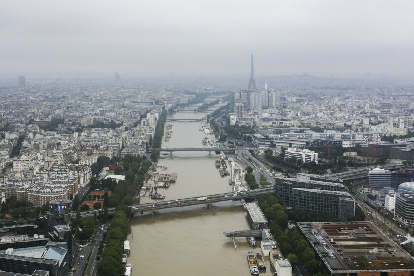 General view from a helicopter of the river Seine which has been overflowing its banks in Paris, Friday, June 3, 2016. Paris' Seine River has been climbing steadily following days of heavy rainfall but until now has done little damage beyond the steep embankments on either side. (AP Photo/Markus Sc