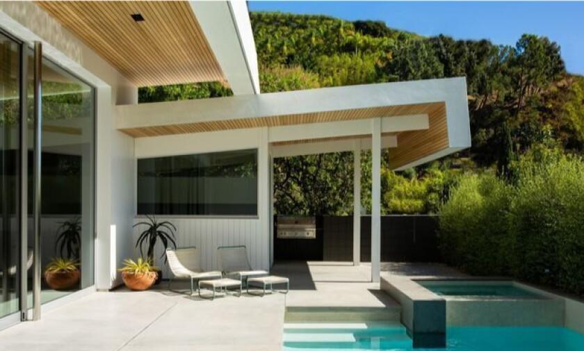 Jason Statham's stylish Midcentury opens to a private backyard