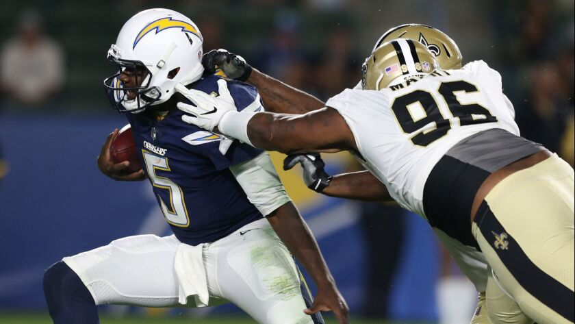 CARSON, CA, SUNDAY, AUGUST 20, 2017 - Chargers quarterback Cardale Jones is sacked by Saints defensi