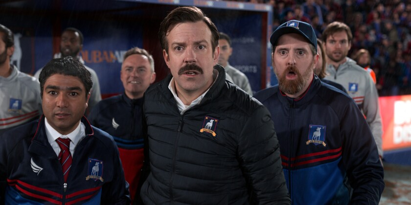 """Nick Mohammed, Jason Sudeikis and Brendan Hunt look very surprised in """"Ted Lasso."""""""