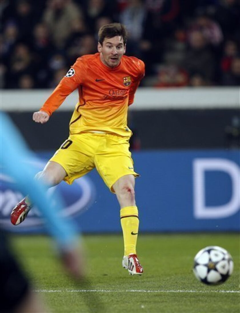 Barcelona's Lionel Messi scores the opening goal during his Champions League quarterfinal soccer match against Paris Saint Germain in Paris,Tuesday, April 2, 2013. (AP Photo/Christophe Ena)..