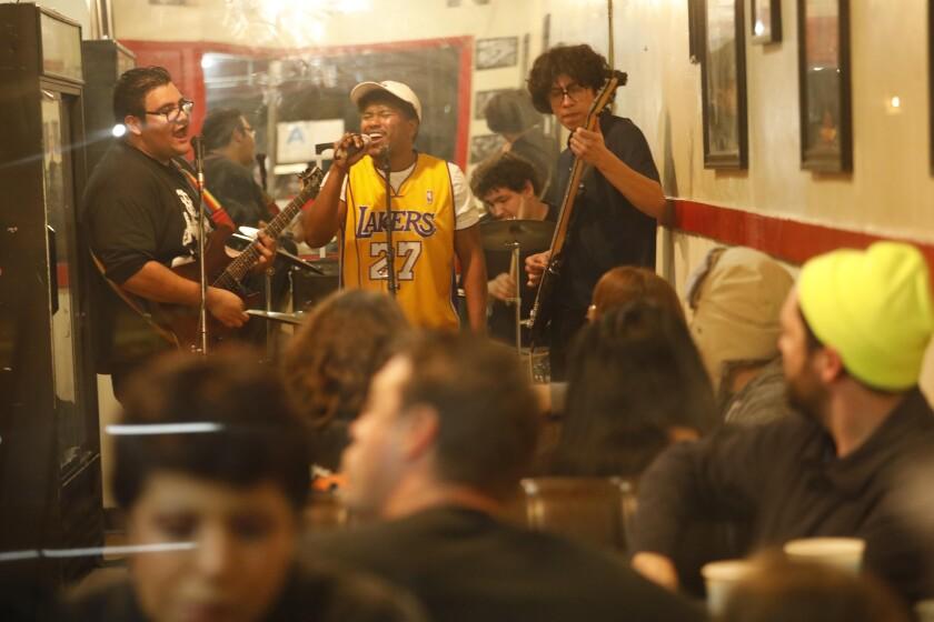 A band plays at Alexander's Hub Burritos, an East Compton restaurant
