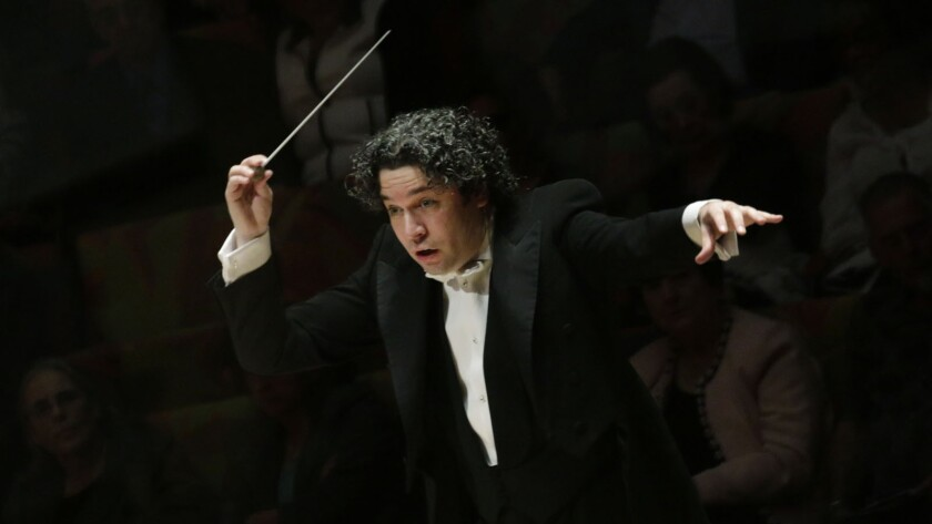 """""""I want people to close their eyes and listen and say, 'This is the sound of the L.A. Philharmonic,'"""" Gustavo Dudamel said. He's pictured here conducting the Los Angeles Philharmonic in John Adams' """"City Noir"""" at Walt Disney Concert Hall."""