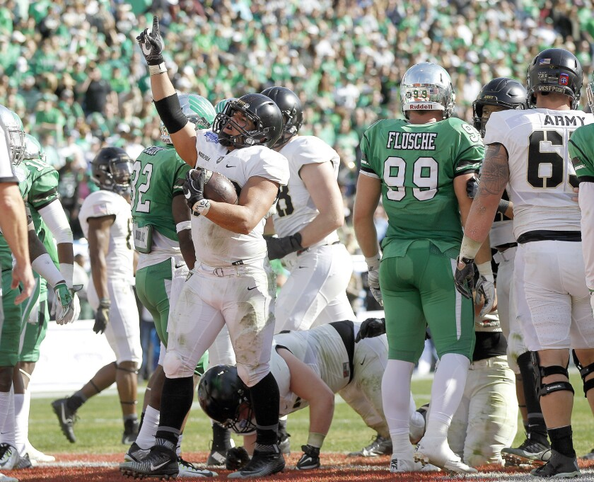 Army running back Darnell Woolfolk celebrates his second-quarter touchdown against North Texas on Dec. 27.