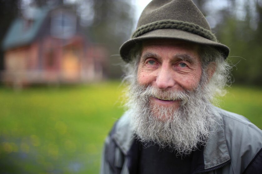 In this photo taken on Friday, May 23, 2014, Burt Shavitz poses on his property in Parkman, Maine. Shavitz, the Burt behind Burt's Bees, still lives in rural Maine after leaving the company that was later sold for millions by his former business partner, Roxanne Quimby. He said he has no regrets, and that he doesn't need much. (AP Photo/Robert F. Bukaty)
