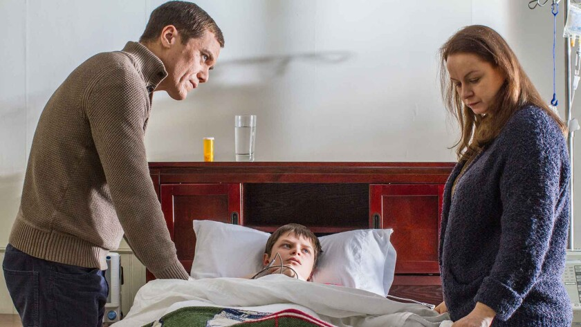 "Michael Shannon, left, Charlie Tahan and Samantha Morton in the movie ""The Harvest."""