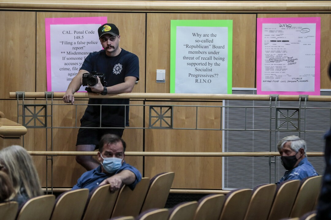 """Eli Kay, filmmaker with """"Red, White and Blueprint,"""" looks on at the Shasta County Board of Supervisors meeting"""