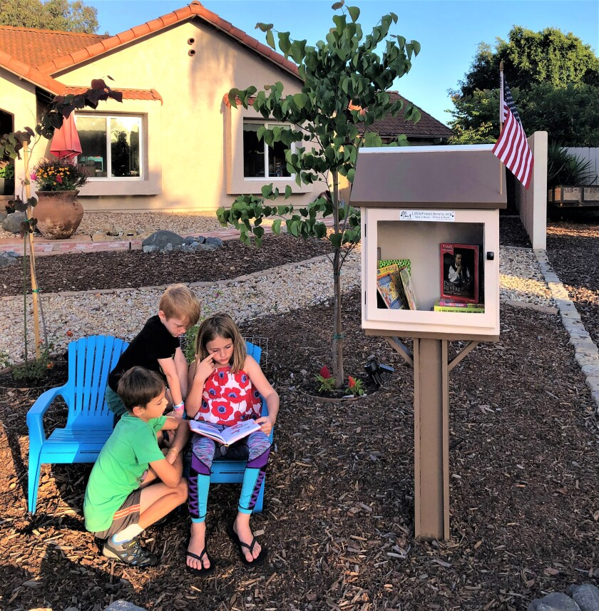 Little Free Library in Vista with friend.jpg