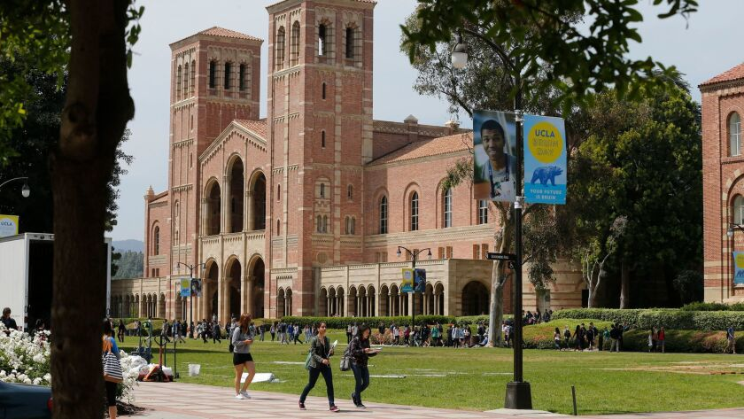 Students walk across the UCLA campus.