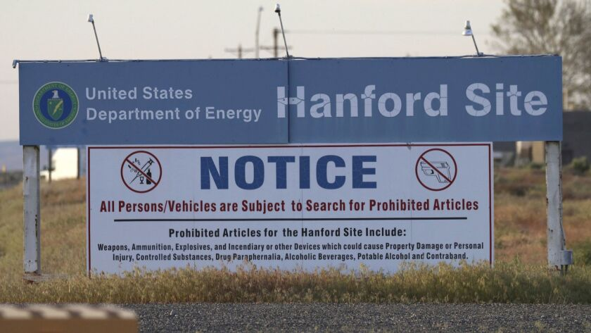 FILE - In this May 9, 2017, file photo, signs are posted at an entrance to the Hanford Nuclear Reser