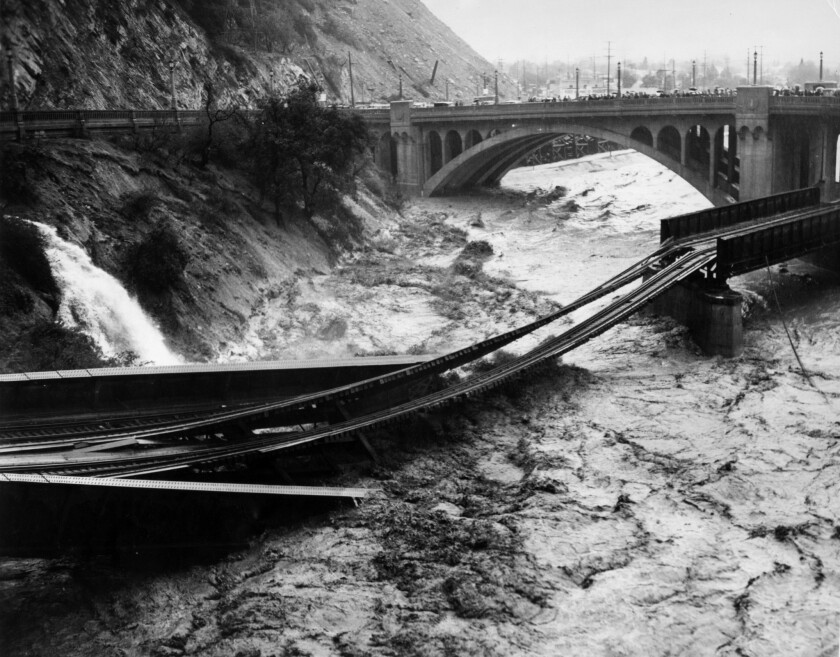 March 2, 1938: Floodwaters in Los Angeles River destroy Southern Pacific railroad bridge.