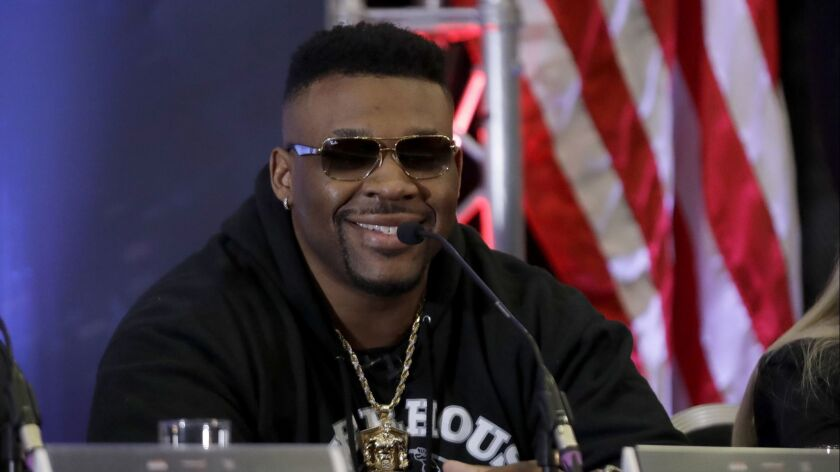 U.S. heavyweight boxer Jarrell Miller smiles during a press conference with British heavyweight boxe