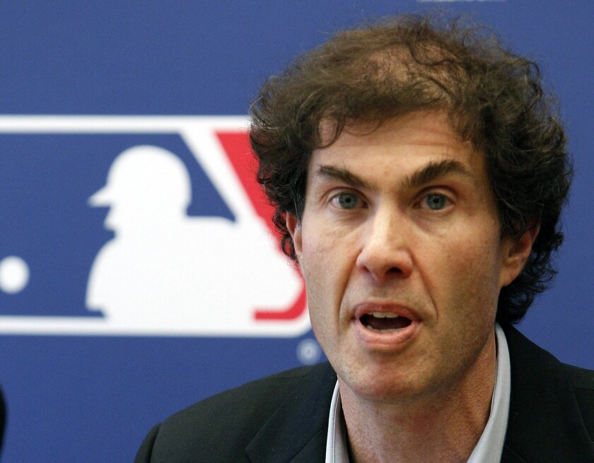 Michael Weiner, executive director of the Major League Baseball Players Assn., shown in 2011, continues to work despite being diagnosed with brain cancer last year.
