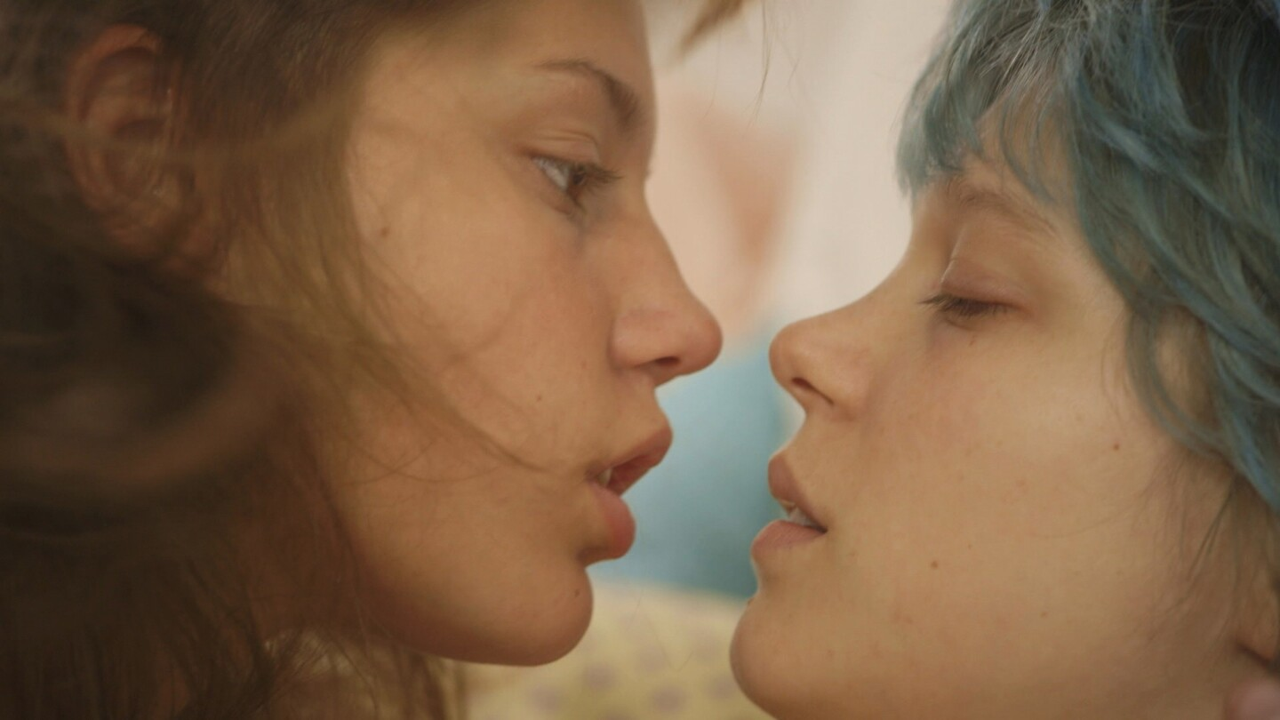 """In the French lesbian love story """"Blue Is the Warmest Color,"""" 15-year-old Adele has plans to become a teacher, but her life changes dramatically when she meets Emma, a blue-haired art student at a nearby college who initiates a romance."""