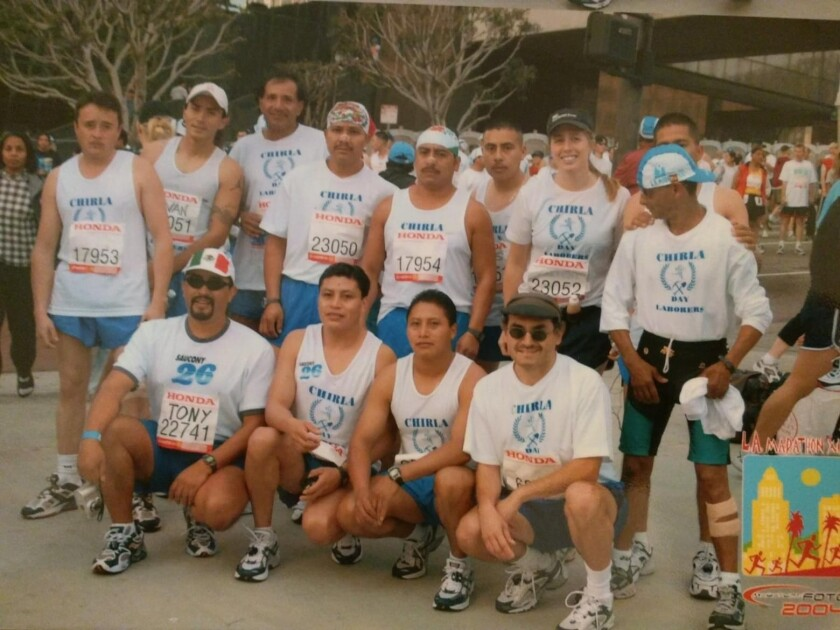 A group of runners pose for a photo.