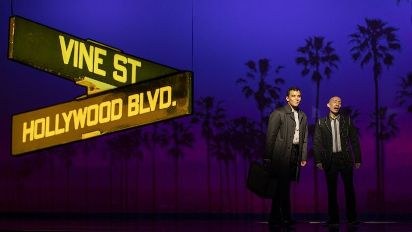 "Conrad Ricamora, left, and Francis Jue star in ""Soft Power,"" a David Henry Hwang play with Jeanine Tesori music having its world premiere at the Ahmanson Theatre."
