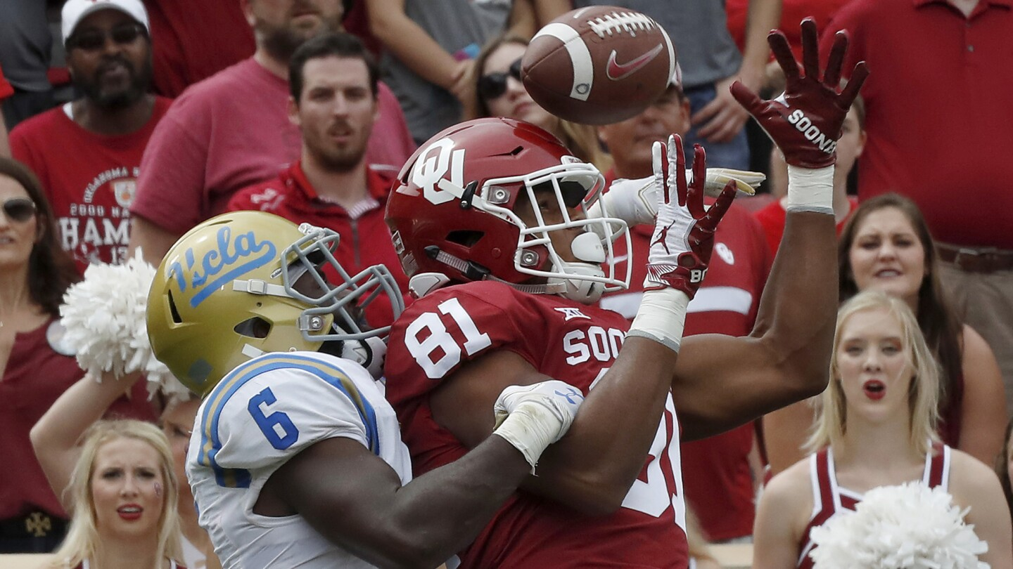 Bruins strong safety Adarius Pickett interferes with Sooners tight end Brayden Willis in the fourth quarter.