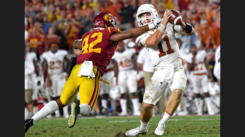 USC linebacker Uchenna Nwosu forces Texas quarterback Sam Ehinger into a bad throw and interception during the fourth quarter at the Coliseum last season.