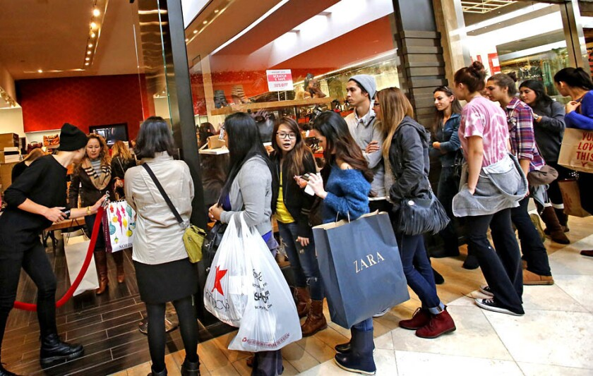Black Friday shoppers in Costa Mesa. November retail sales missed expectations.