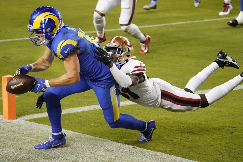 The Rams' Cooper Kupp drops a potential touchdown pass a  49ers' Emmanuel Moseley defends.