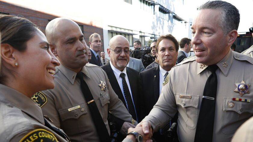 Los Angeles County Sheriff Alex Villanueva, right, greets members of the force after his swearing-in ceremony on Dec. 3, 2018.