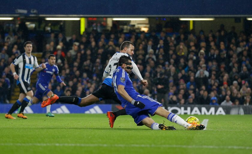 Chelsea's Diego Costa, right, scores his side's first goal during the English Premier League soccer match between Chelsea and Newcastle United at Stamford Bridge stadium in London, Saturday, Feb. 13, 2016.  (AP Photo/Matt Dunham)