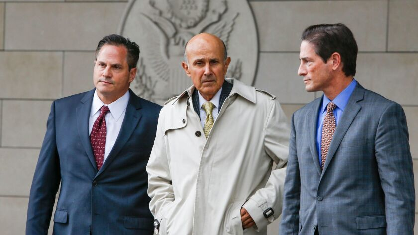 Former Los Angeles County Sheriff Lee Baca, center, leaves federal court, where prosecutors announced they will retry him on charges of obstructing an FBI investigation.