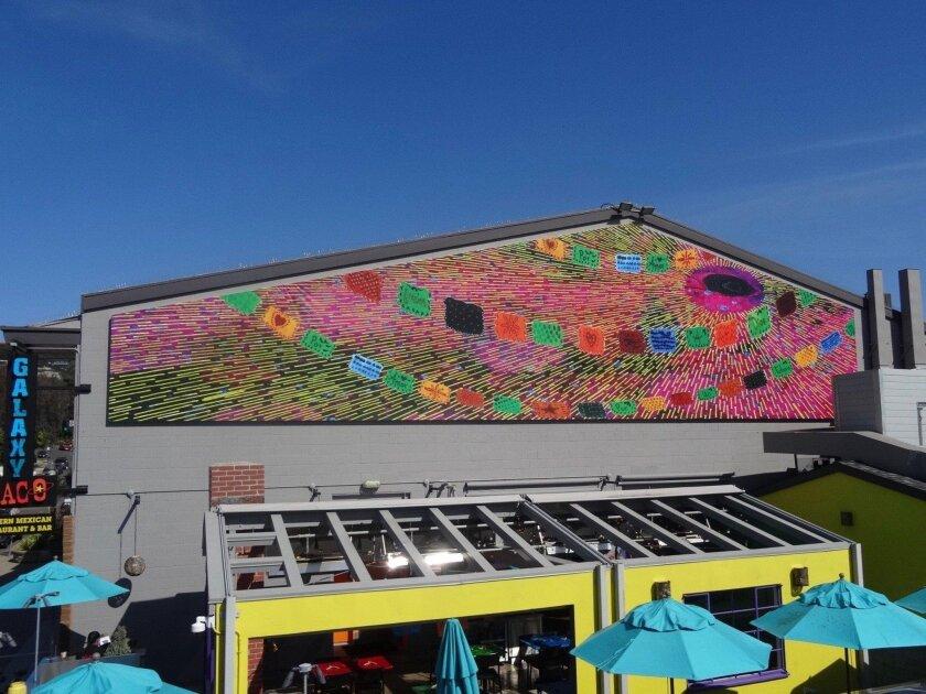 """""""Demos Gracias"""" by Lorenzo Hurtado Segovia is installed at the Galaxy Taco building in La Jolla Shores."""