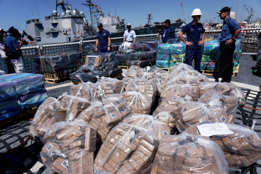 Bales of cocaine seized from smugglers by U.S. and Canadian personnel are unloaded from the Coast Guard cutter Boutwell in this file photo.