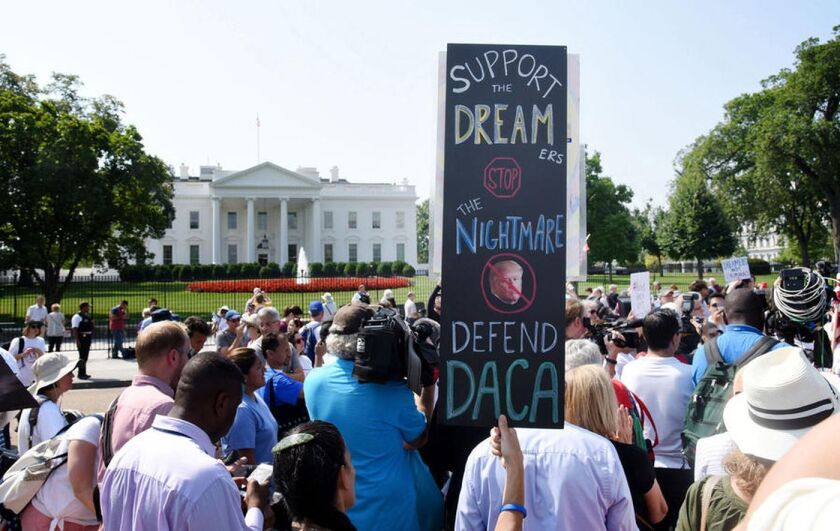 Demonstrators supporting a legal path for so-called Dreamers gather outside the White House.