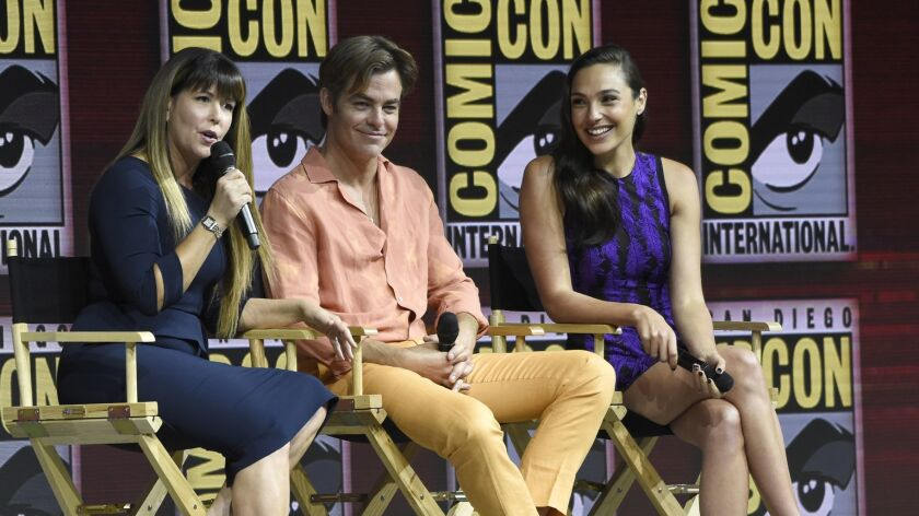 "Patty Jenkins, left, Chris Pine and Gal Gadot speak at the panel for ""Wonder Woman 1984"" at Comic-Con International on Saturday in San Diego."