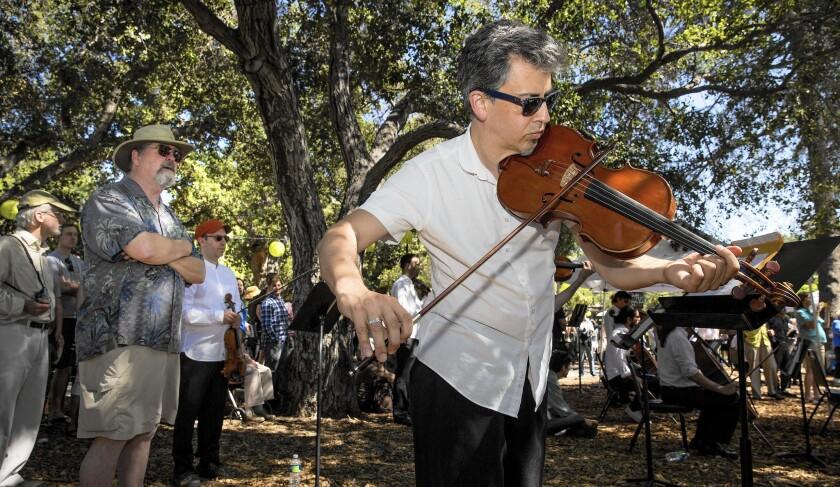 "CalArts Ensemble violist Mark Menzies performs John Luther Adams' ""Sila"" on Thursday at Libbey Park."