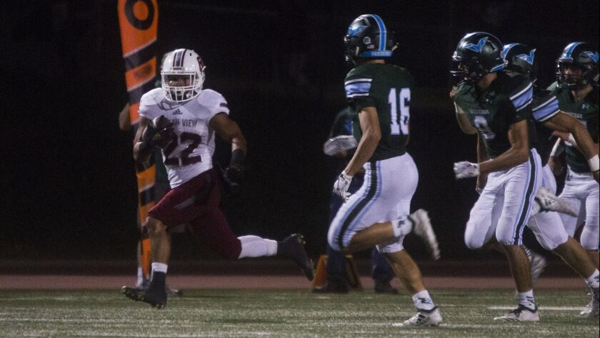 Ocean View's Rodrigo Adame runs the ball for a large gain against Irvine in the first round of the C